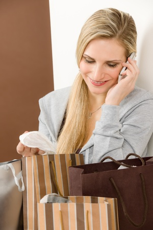 designer bag: Shopping fashion woman on phone in designer clothes with bag