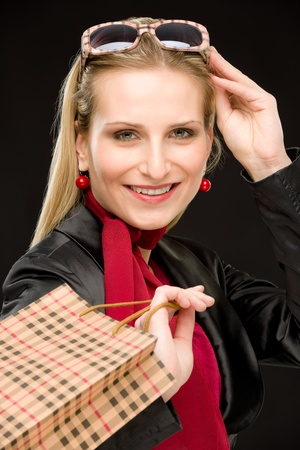 designer bag: Portrait happy fashion woman in designer clothes with shopping bag Stock Photo