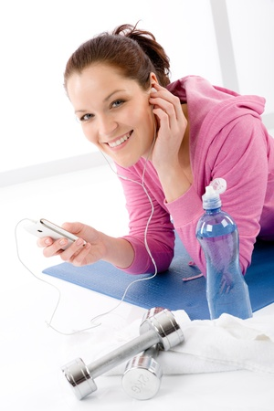 Fitness woman listen music mp3 relax gym on white background Stock Photo - 9330938