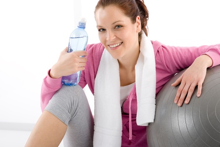 Fitness woman relax water bottle ball sportive outfit Stock Photo - 9330936