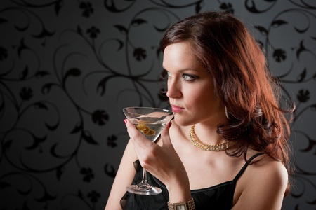 cocktail dress: Cocktail party woman evening dress enjoy drink on black background Stock Photo