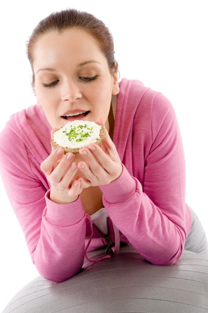 Fitness happy woman eat snack sportive outfit in gym Stock Photo - 9331775