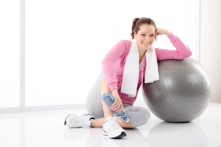 Fitness woman relax with water bottle exercise ball photo
