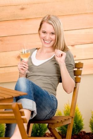 Garden happy woman enjoy glass wine on terrace photo