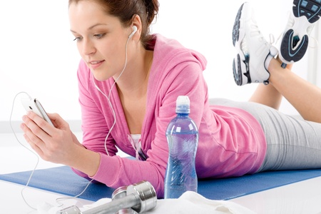 Fitness woman listen music mp3 relax gym on white background photo