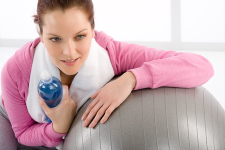 Fitness woman relax water bottle ball sportive outfit Stock Photo - 9368422