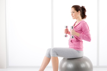 Fitness happy tired woman exercise dumbbell ball on white Stock Photo - 9368368