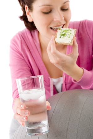 Fitness woman relax with glass water snack sportive outfit photo
