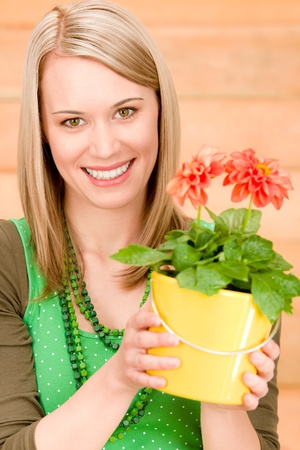 Portrait happy woman hold potted flower spring in garden photo