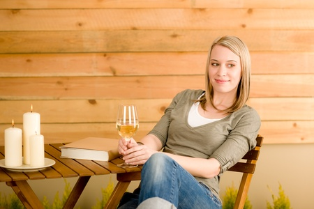 Garden happy woman enjoy glass wine sitting on terrace photo