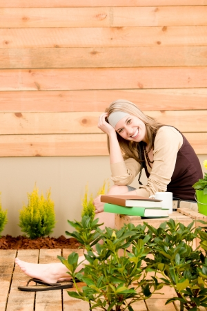 Garden happy woman relax on terrace in spring Stock Photo