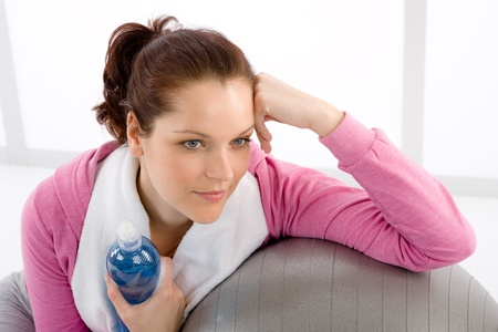 Fitness woman relax water bottle ball sportive outfit Stock Photo - 9425471