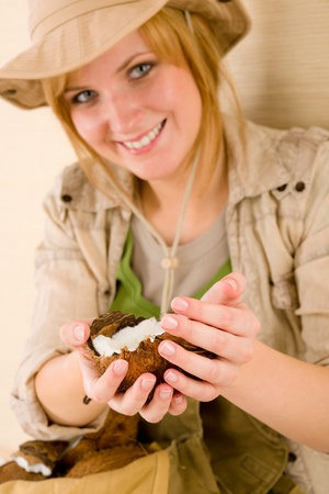 Portrait of safari happy young woman with coconut photo
