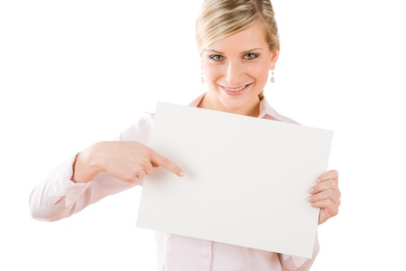 Happy businesswoman pointing front at blank advertising banner on white photo