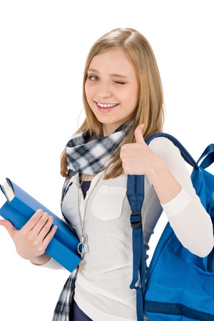 Thumbs up student teenager woman with shoolbag on white Stock Photo - 9499533