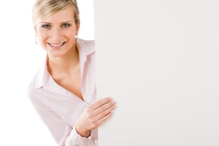 Happy businesswoman behind blank advertising banner landscape photo