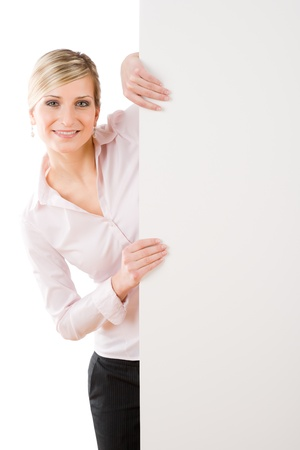 Happy businesswoman behind blank advertising banner standing photo