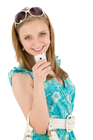 Teenager woman with mobile phone wear summer dress photo