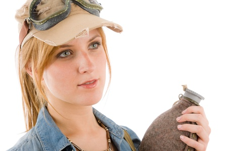Adventure young woman with pilot goggles hold bottle photo