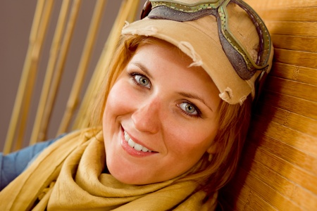 Young woman sunburned face with pilot goggles close-up photo
