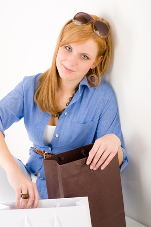 designer bag: Shopping young woman with paper bag in designer clothes