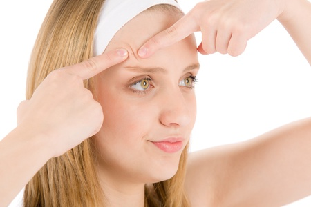 Acne facial care teenager woman squeezing pimple on white Stock Photo - 9527042