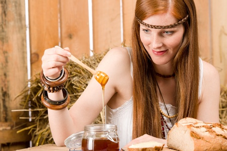 redhair: Young red-hair hippie woman organic breakfast in barn country style Stock Photo