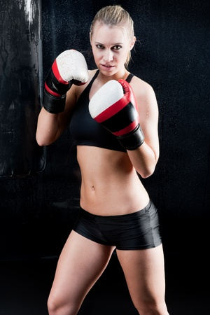 Sexy boxing training woman with gloves in gym photo