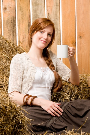 redhair: Young red-hair romantic woman holding cup country style in barn