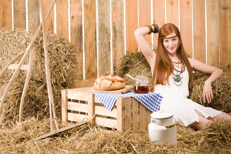 redhair: Red-hair young hippie woman breakfast on hay in barn country style