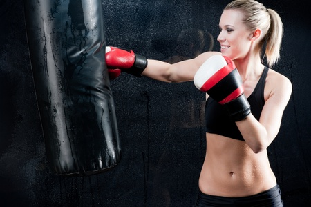 Boxing training woman with punching bag in gym wear gloves Stock Photo - 9554030