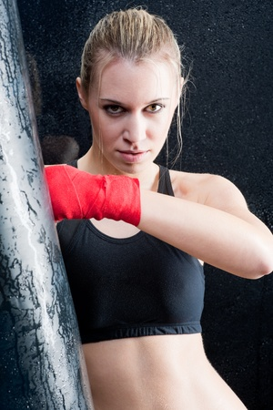 Boxing training blond woman sparring and sweating photo