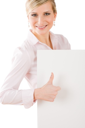 Happy business woman behind blank banner thumbs up Stock Photo - 9554055