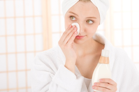 remove: Acne facial care teenager woman clean skin in bathroom Stock Photo