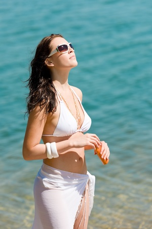 Summer woman in bikini alone on beach sunbathing Stock Photo - 9554131