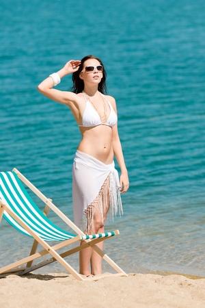 Summer young woman sunbathing in bikini on beach Stock Photo - 9554135