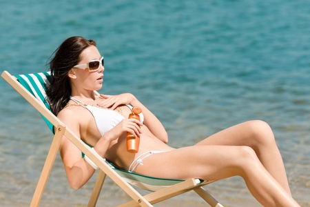 Summer young woman sunbathing in bikini on beach Stock Photo - 9554124