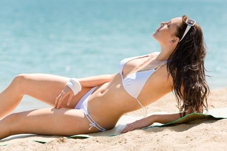 Summer beach young woman sunbathing in bikini alone Stock Photo - 9554130