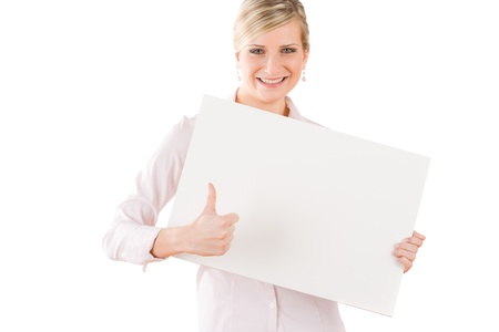 Happy business woman behind blank banner thumbs up photo