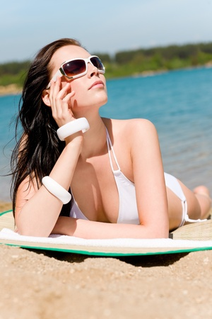 Summer beach young woman sunbathing in bikini alone Stock Photo - 9554128