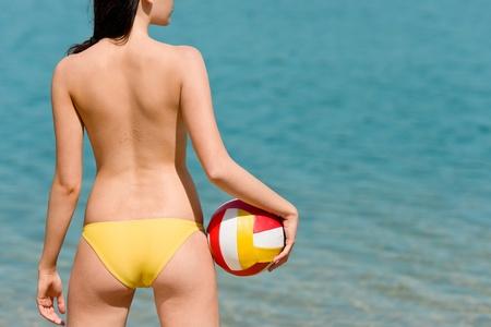 Summer beach topless woman enjoy sun hold ball Stock Photo - 9554123