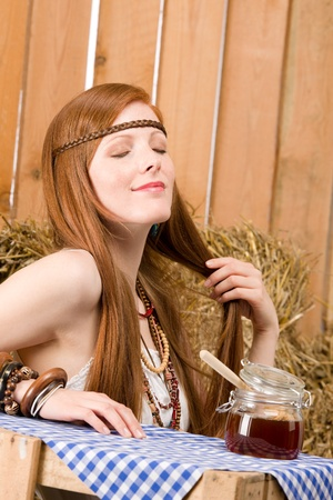 redhair: Young red-hair hippie woman have organic breakfast in barn Stock Photo
