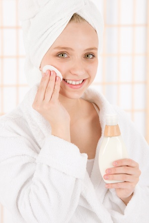 Acne facial care teenager woman clean skin in bathroom Stock Photo - 9554113