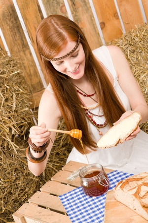 redhair: Young red-hair hippie woman have organic breakfast in country style