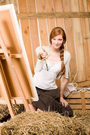 redhair: Young red-hair romantic woman in barn painting on canvas