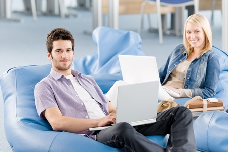 Students at high school or university working on laptop studying Stock Photo - 9682648