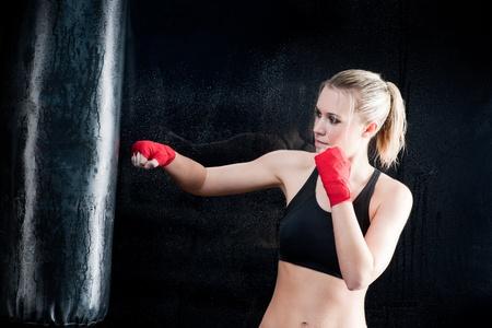 punching bag: Boxing training woman sparring punching bag in gym wear gloves Stock Photo