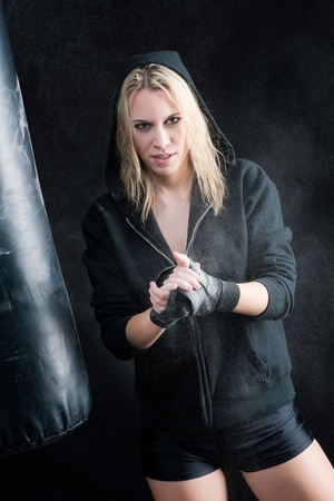 Blond boxing woman prepare for training with punching bag Stock Photo - 9682674