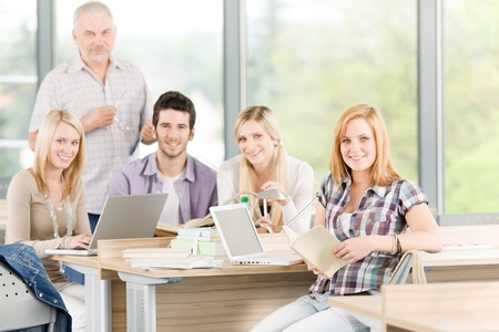 High-school or university young study group with mature professor photo