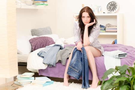 Attractive girl dressing up in the morning in student apartment photo